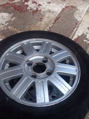 2 X FIESTA ALLOYS WITH EXCELLENT TYRES