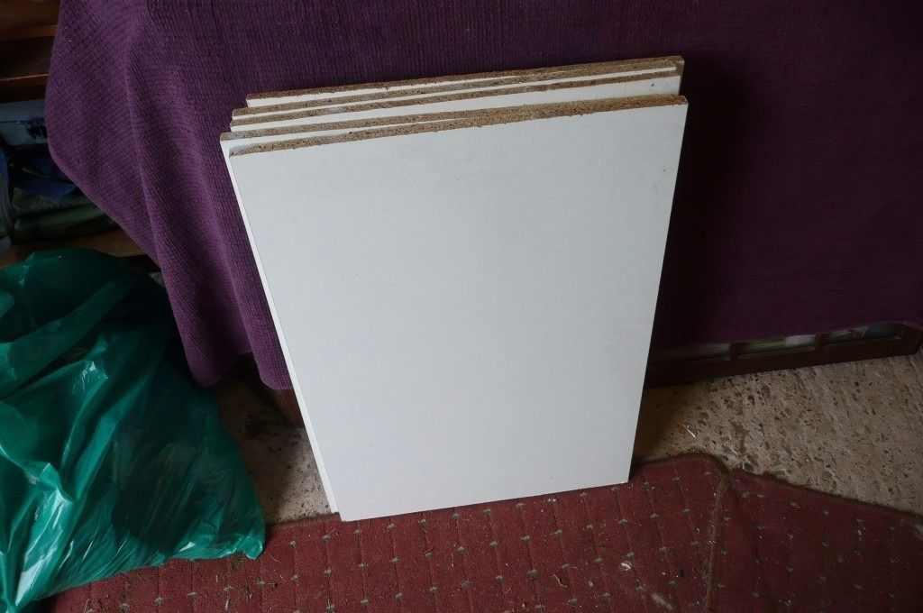 5 white faced boards. shelving. wooden,