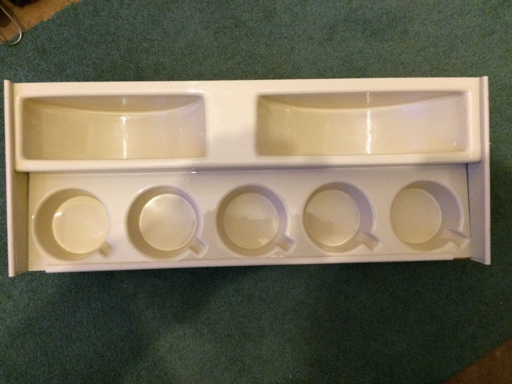 Caravan cup and plate rack with insert.