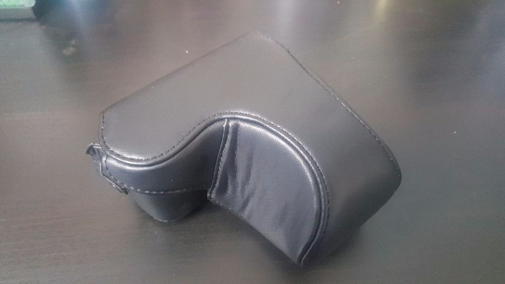 Dengpin camera case fits all band new leather black.