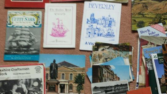 Tourist brochures . fairly old. Devon.norfolk broads.staitly homes . London at actions. Postcards.