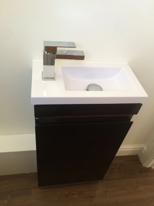 Brand New Never Used black gloss vanity unit and sink, tap and push down plug.