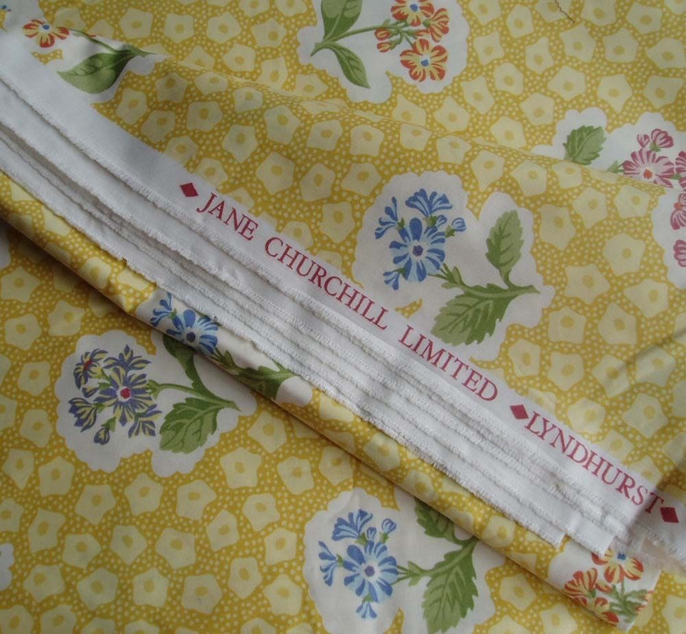 FABRIC - JANE CHURCHILL LTD. LYNDHURST. GOLDEN YELLOW with COLOURED FLOWER POSIES, glazed cotton.