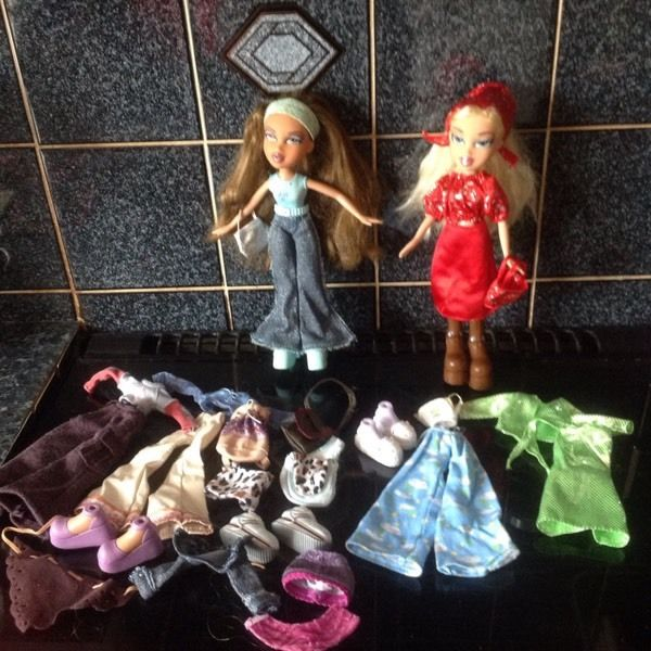 Two original Bratz dolls and outfits