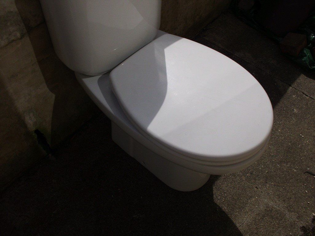 White close coupled toilet and seat