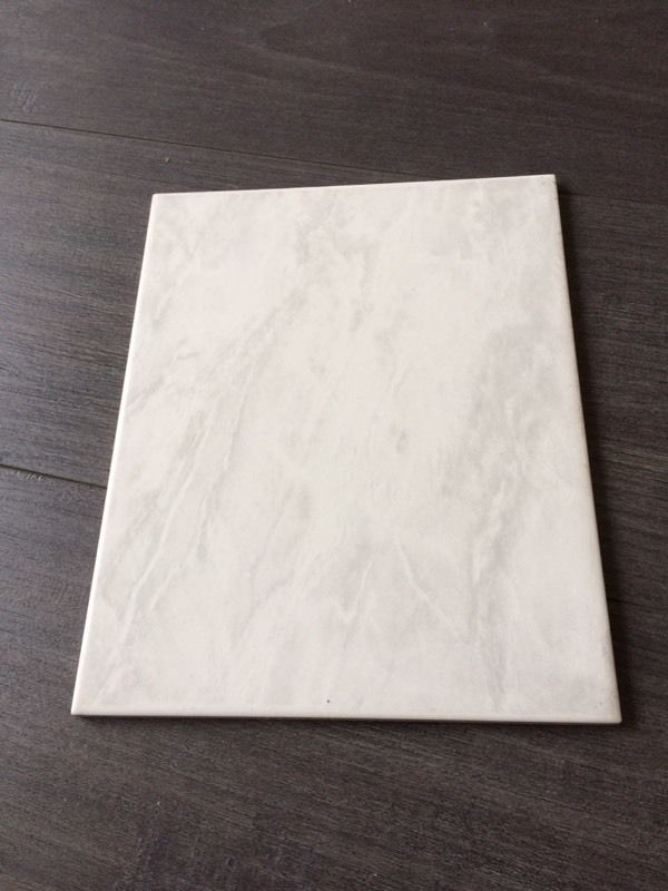 11 white tiles with slight pattern 20cm x 25cm brand new