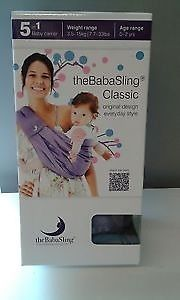 The baby sling - Hardly used - original packaging