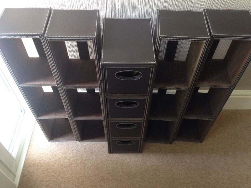 Faux leather DVD storage and drawers.
