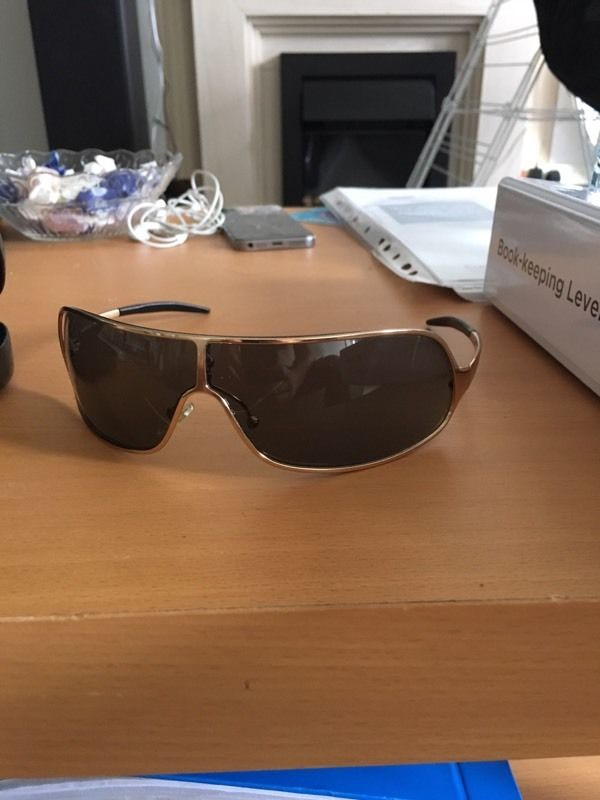 Gucci sunglasses 1690/S black and 1661/S gold frame