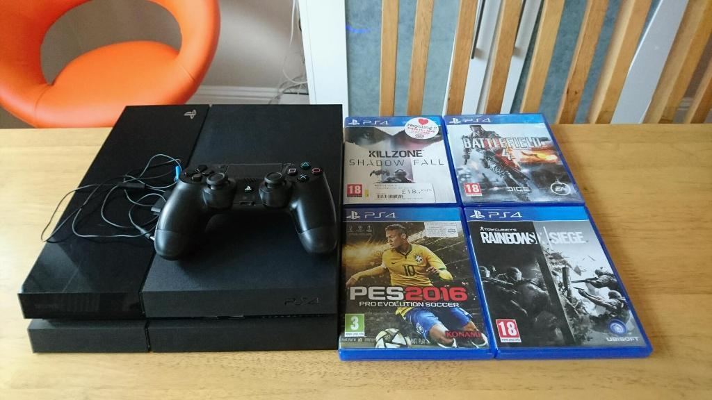 Ps4 500gb black, controller, and 5 games