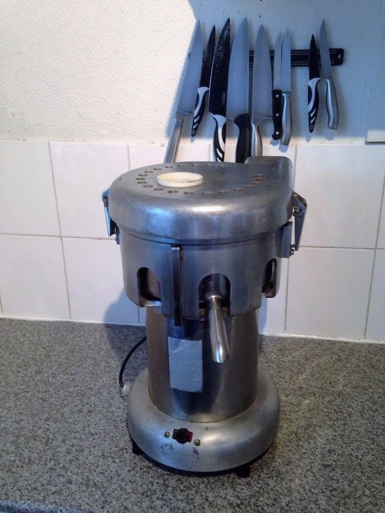 Juicer machine for commercial use.