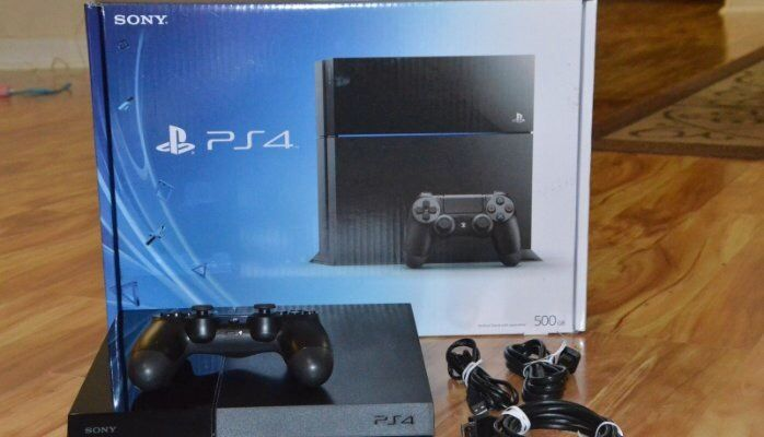 PlayStation 4 with controller and 3 games