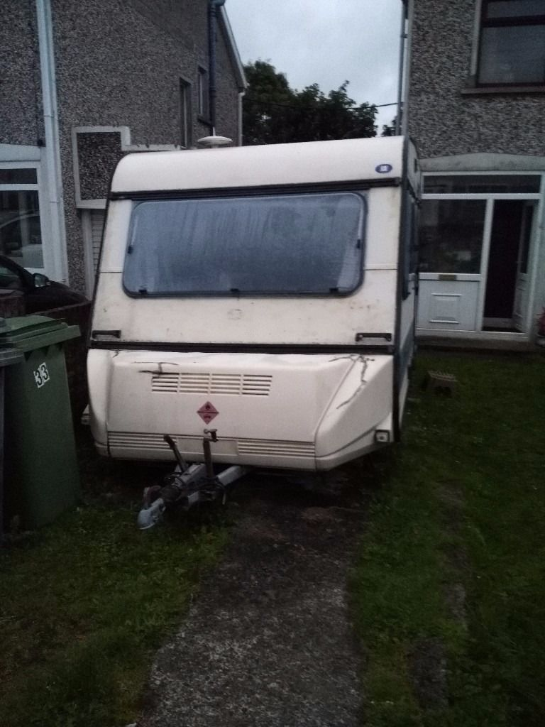 Old solid Adria Caravan with awning and hook up
