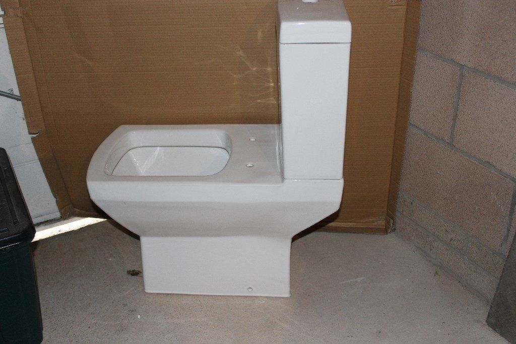 CLOSE COUPLED TOILET SYSTEM