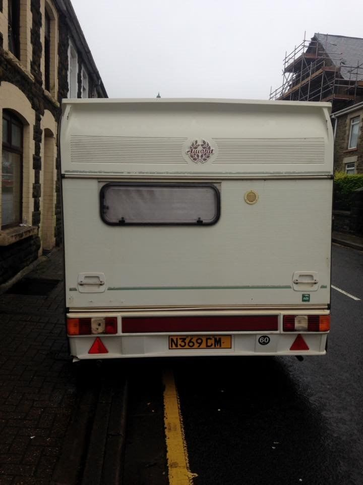 2 birth caravan comes with awning .