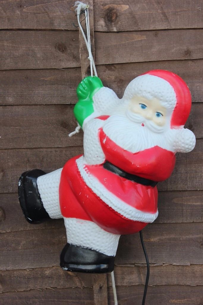 Hanging Father Christmas Santa Decoration outside lights