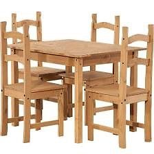 Pine dining table and 4 chairs in very good condition