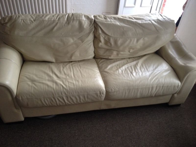 Cream leather fold out settee