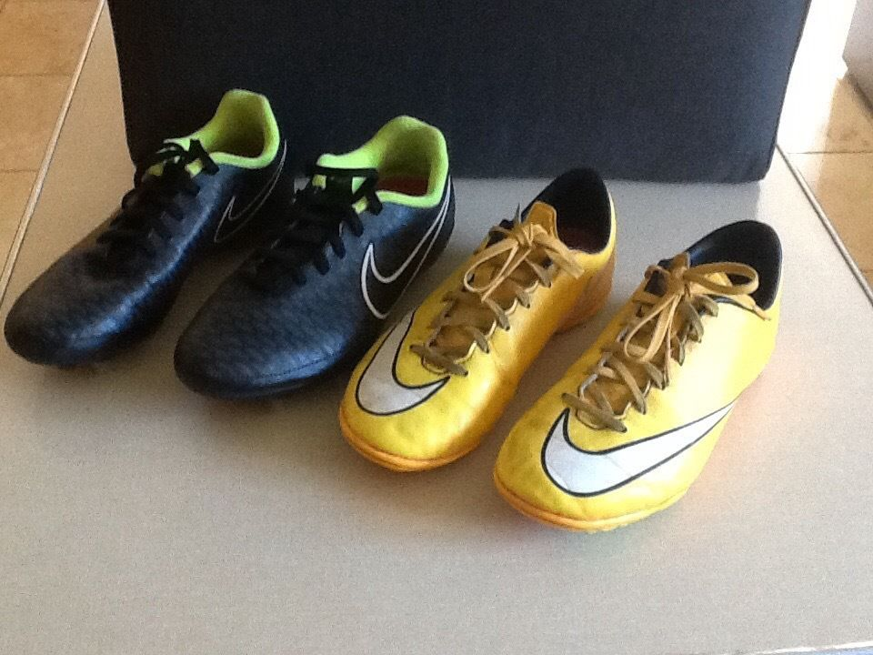 Two Pairs of Nike football shoes, Both are (Size 5)