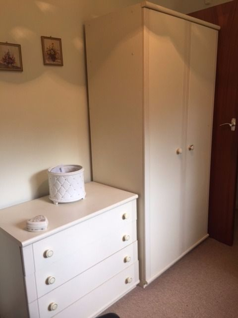 white wardrobe,chest of 4 draws and book case.
