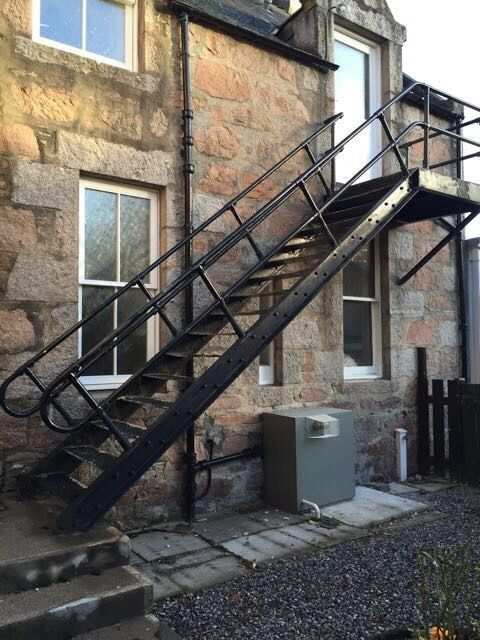 Fire escape stairs, metal,painted black,unassembled,