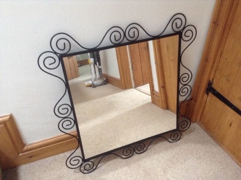 Mirror with black metal surround