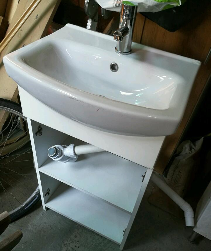 Compact sink in vanity unit, with mixer tap inlet and waste pipes