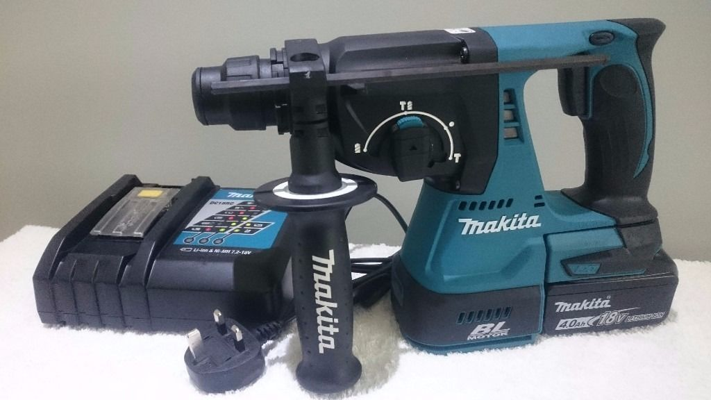 "MAKITA DHR242""BRUSHLESS"" 18v li-ion 3 mode sds drill, 1x4ah batt 36min charger,""AS NEW"" DeWALT"
