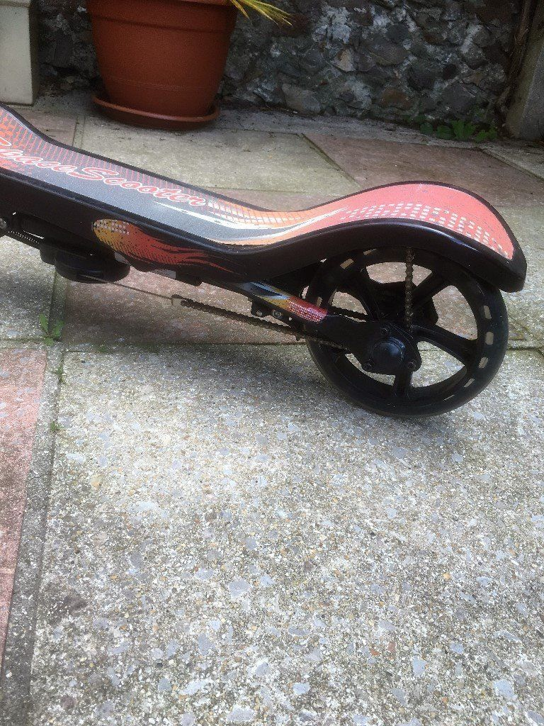 SPACE SCOOTER , PUMP ACTION WITH BRAKE NOT USED AGES 8-65 KIDS OR ADULT SCOOTER.