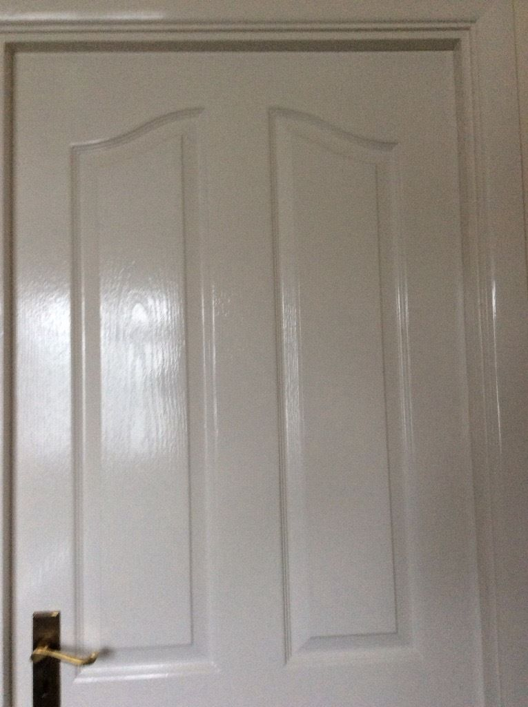 White painted interior door with brass furniture