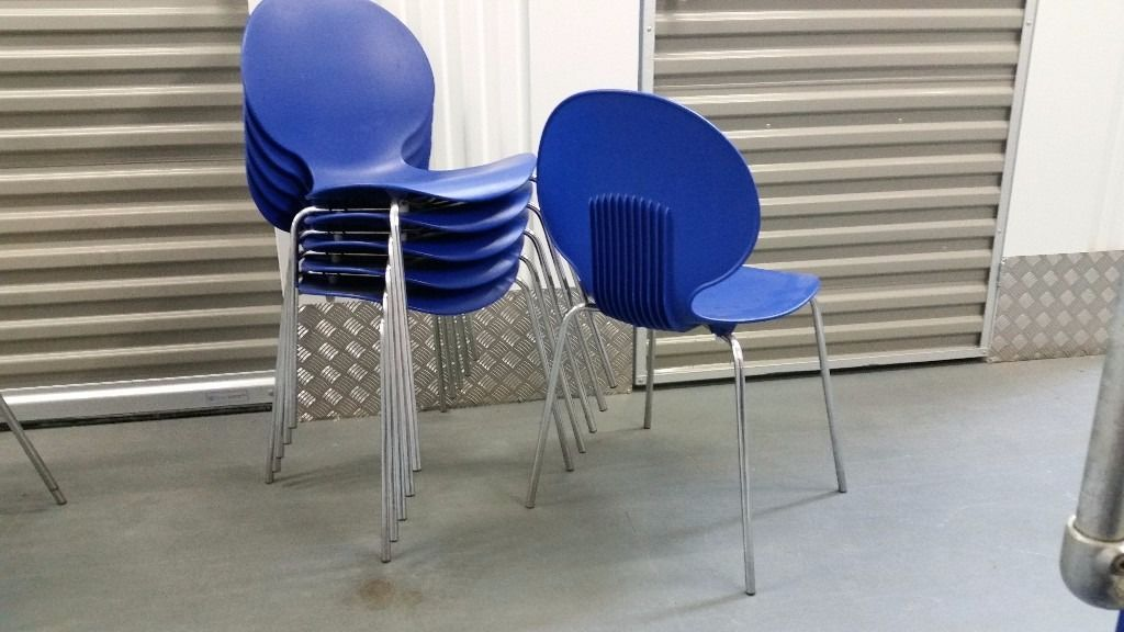 8 Blue chrome frame stacking chairs