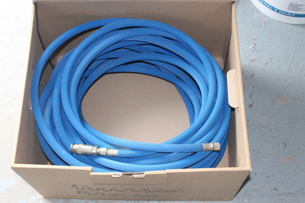 A 30M (100 foot) blue airline hose with standard BSP fittings