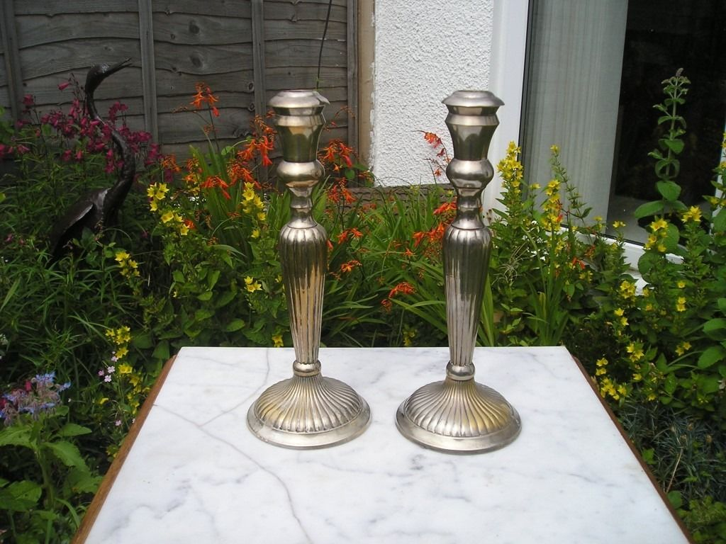 Antique candle sticks - silver over brass