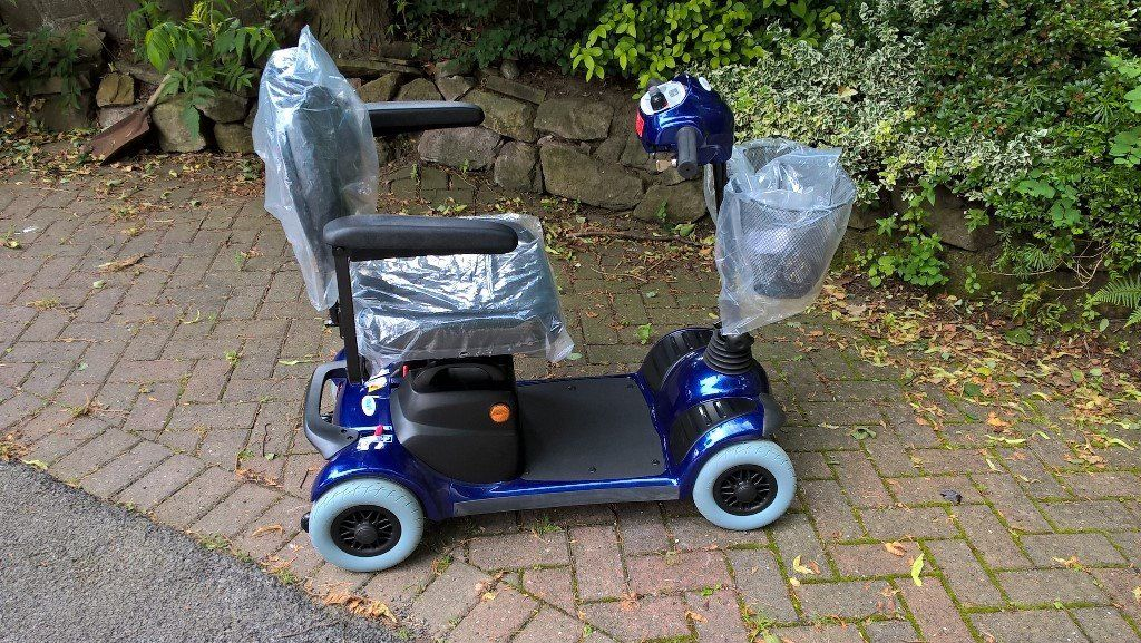 A NEW STRIDER ST 3 Mobility Scooter in Sapphire Blue