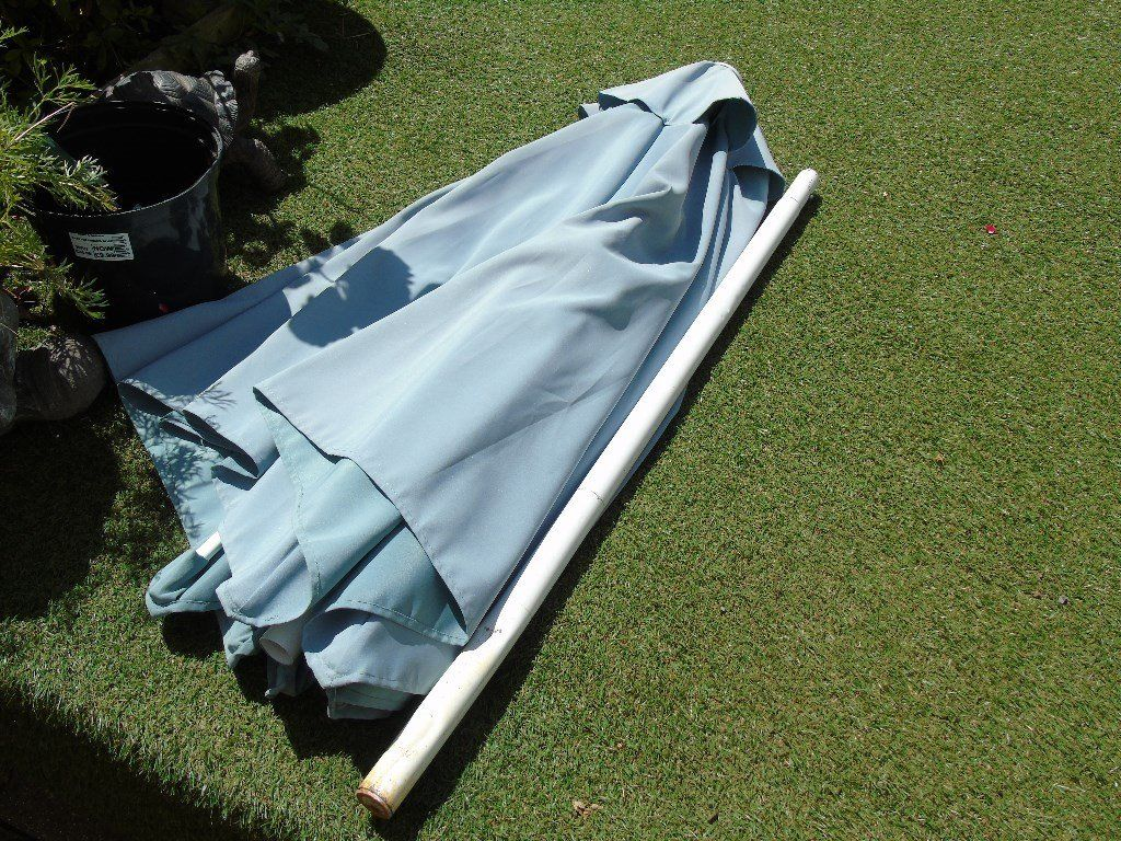 used garden parasol with metal stand