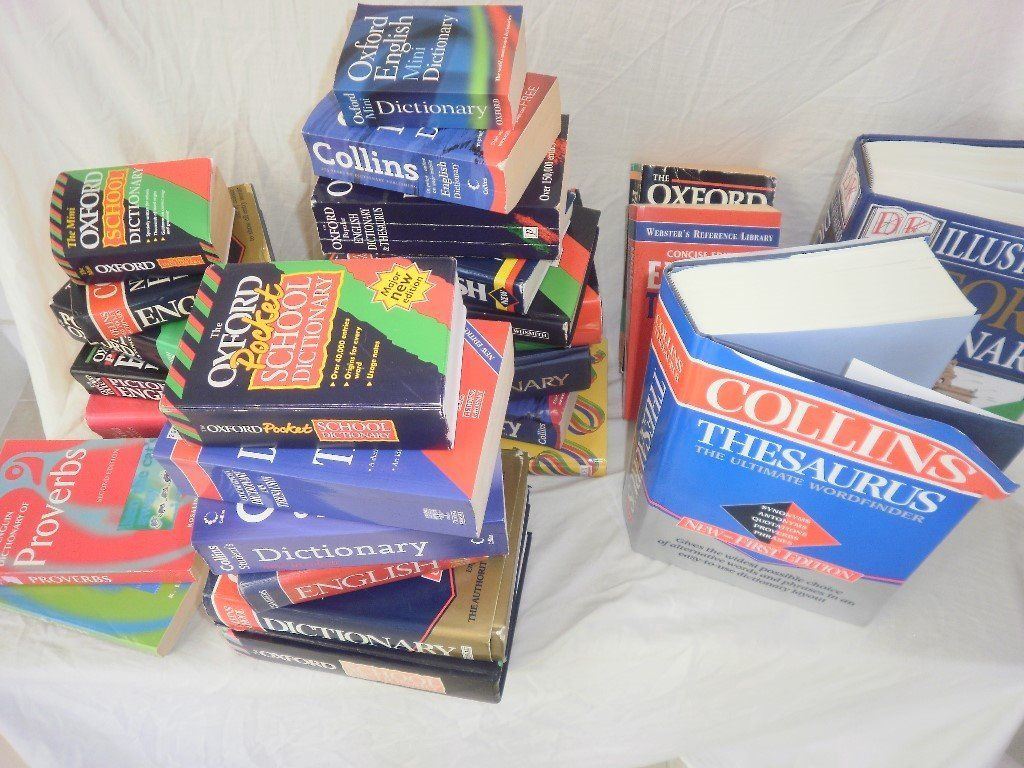 Box of dictionaries, thesaruses and study guides. (mini, school and reference.)