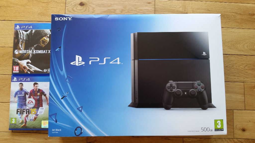 Playstation 4 with 2 games and wireless controller, boxed in fantastic condition, hardly used