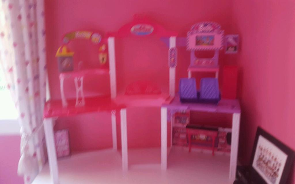 Barbies, houses, car, furniture and accessories