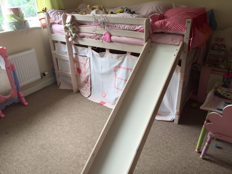 Cabin bed with den and slide