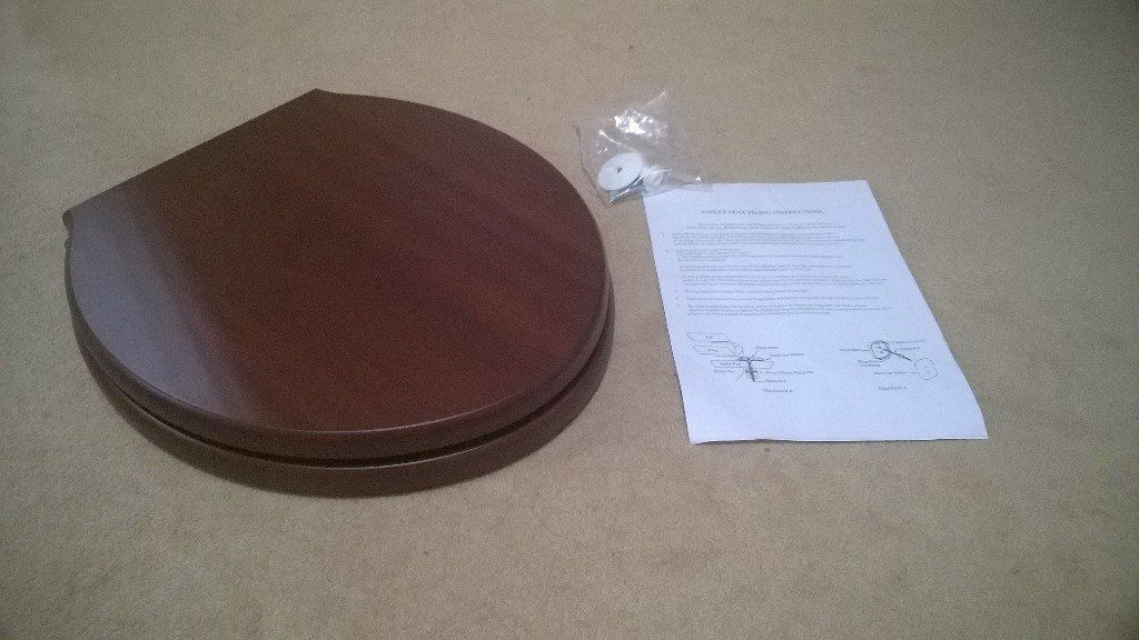 Brand New Mahogany coloured toilet seat.
