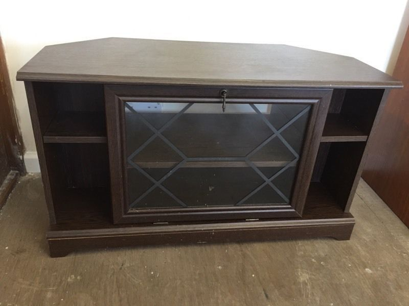 Wooden tv stand with glass door