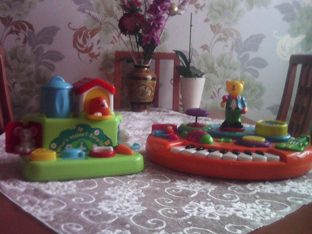 Two children's activity toys.One has animals hidding behind doorsOne has musical instruments.