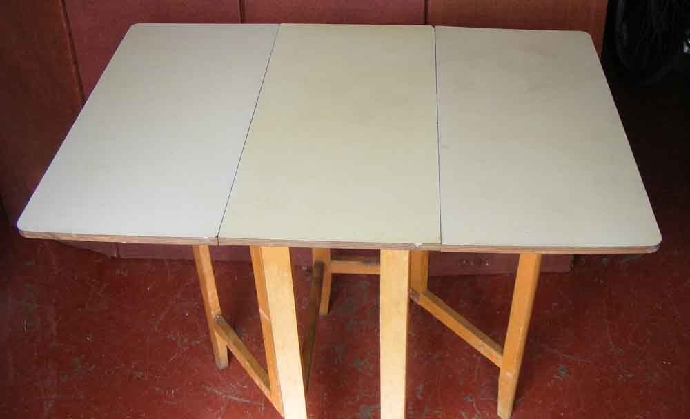 1950's vintage yellow Melamine top drop leaf table- 11.5 x 23.5 x 29.5 ins. folded.