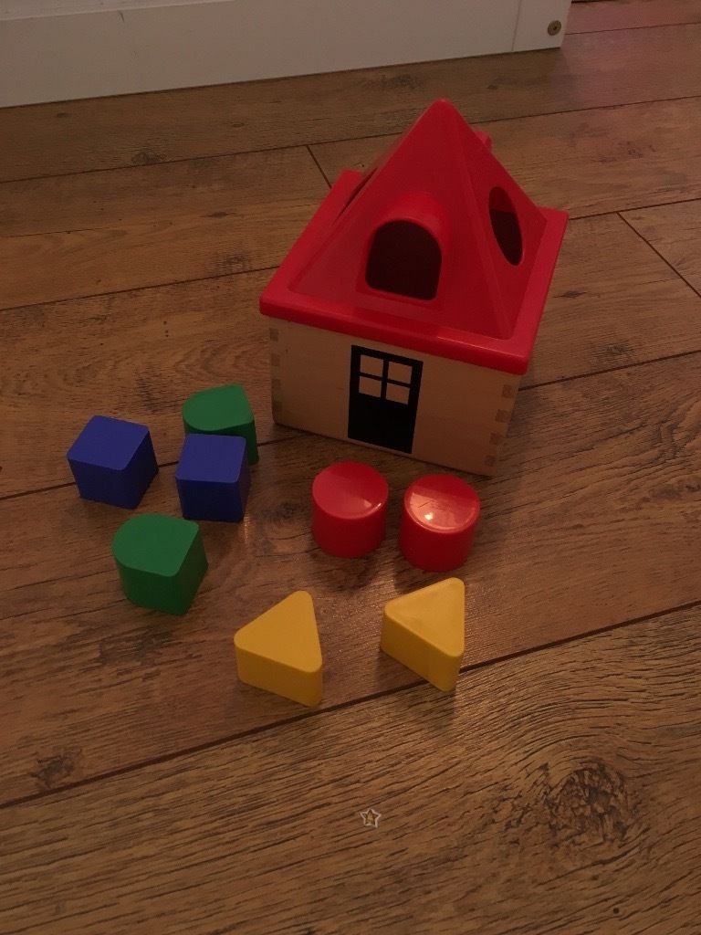 Wooden toy house shape sorter
