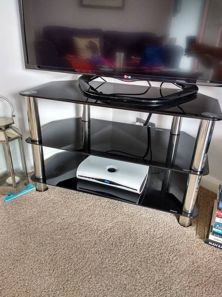 Black glass and chrome TV stand.