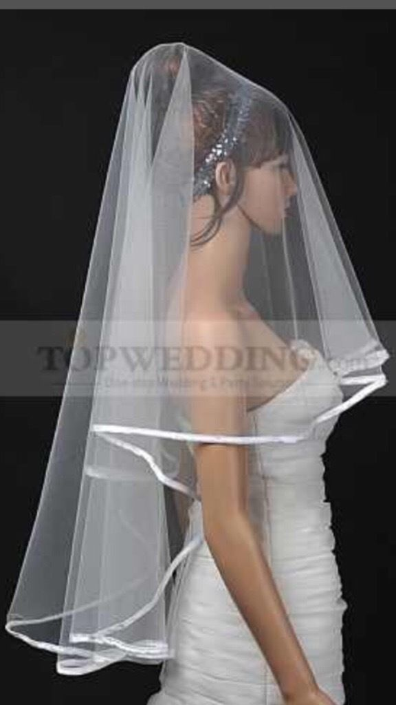 White ribbon edge elbow length veil