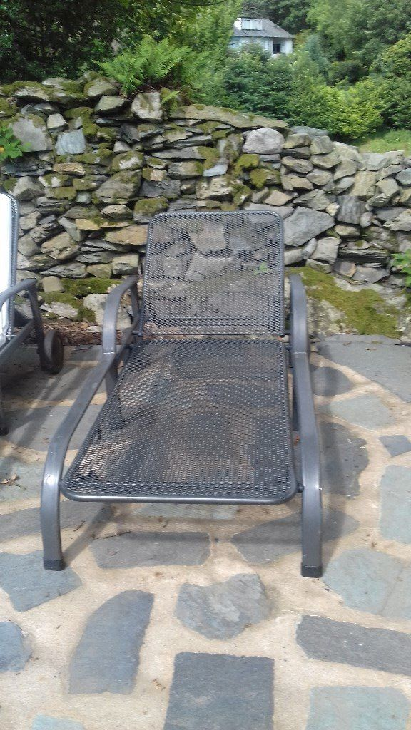 2 metal sun loungers with adjustable head and footrests complete with covers