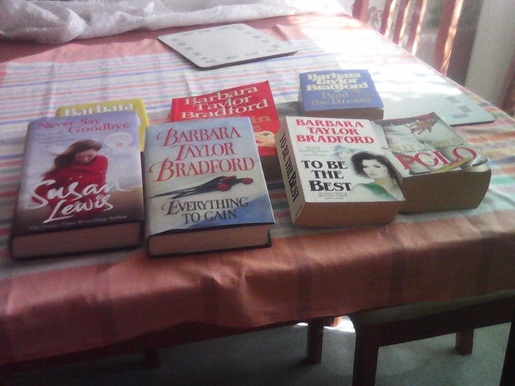 Seven books by authors Barbara Taylor Bradford,Susan Lewis,and Jilly Cooper