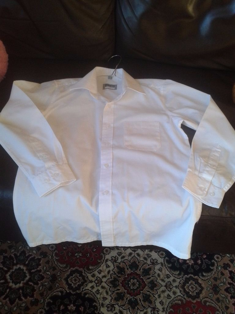 Good quality long sleeve white shirts, boys/girls. Collar sizes 13 and 13 1/2. Say around age 11