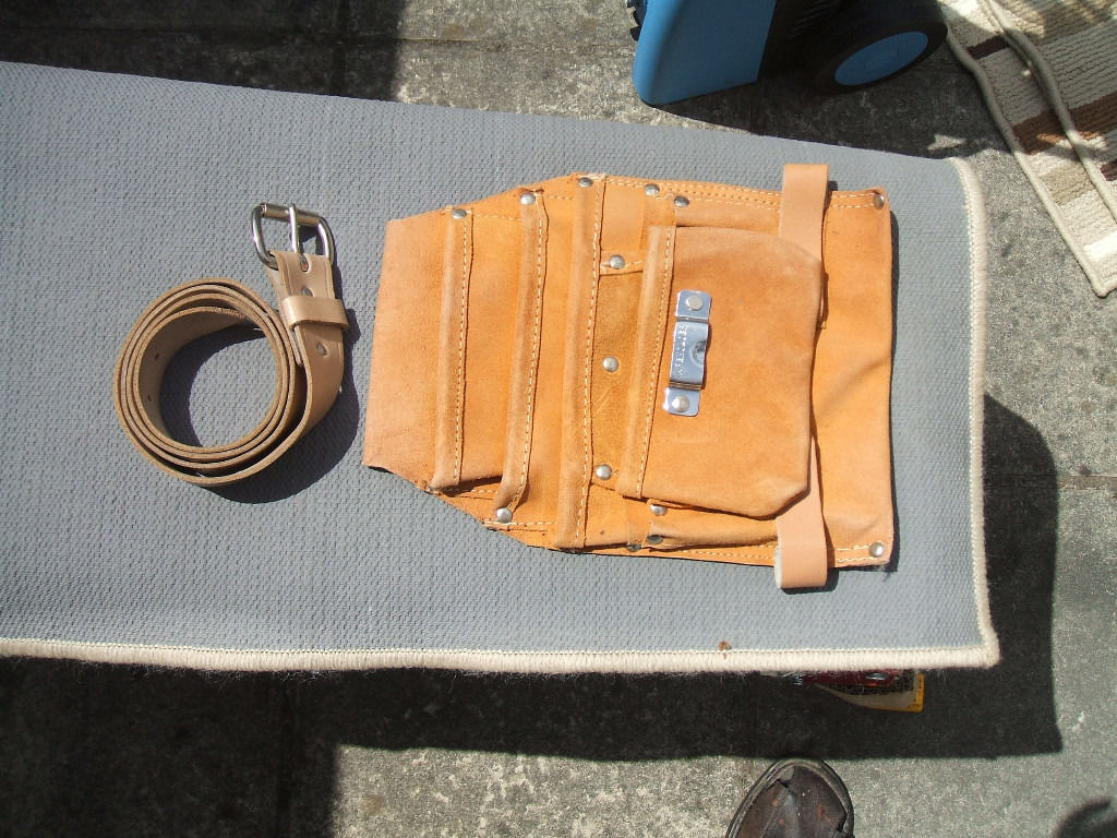 Leather Tool Holder and Leather Buckled Belt.